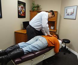 Dr. Hominuk adjusting a patient.