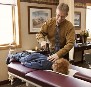 Dr. Westerberg adjusting a child.