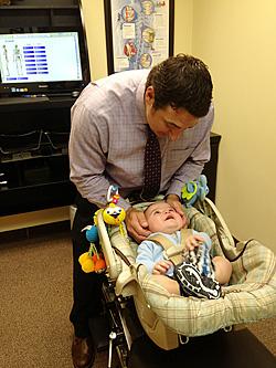 Dr. Verne adjusting infant