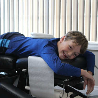 Boy on adjusting table