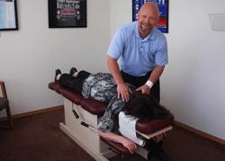 Dr. Blaine, Wasilla Chiropractor, adjusting a patient