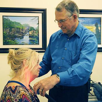 Dr. Jones performing laser on patient