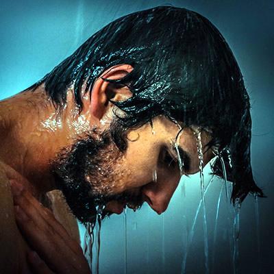 Man on cold shower