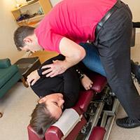 Dr Kennedy adjusting patient