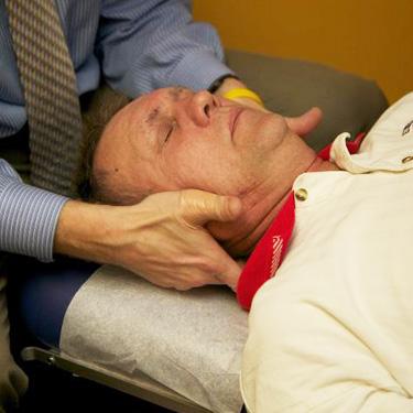 Hands on neck adjustment