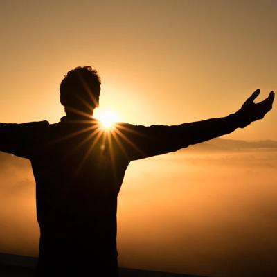 man on mountain top sunset