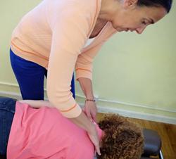 Dr. Christina Angelos adjusting a patient.