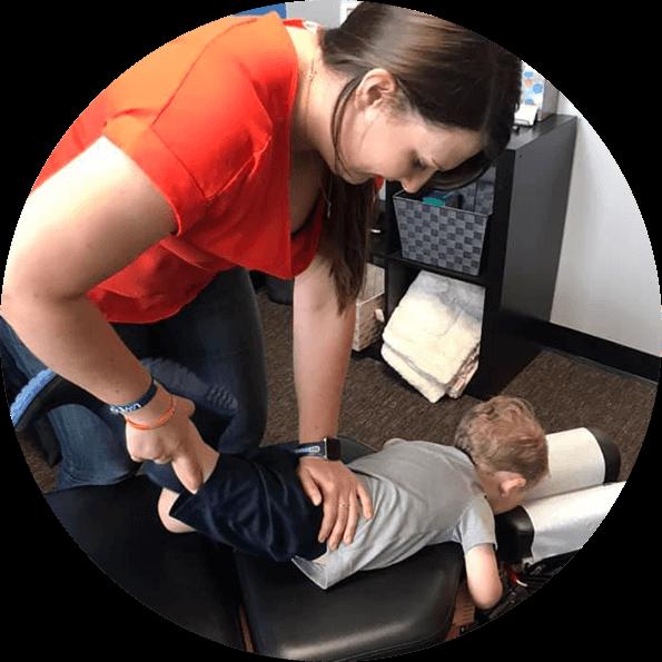 Dr. Lindsey adjusting toddler boy's leg