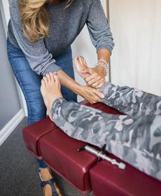 Chiropractor providing a foot massage