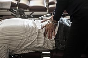 El Cajon Chiropractor Dr. Gina Caserma adjusting a patient