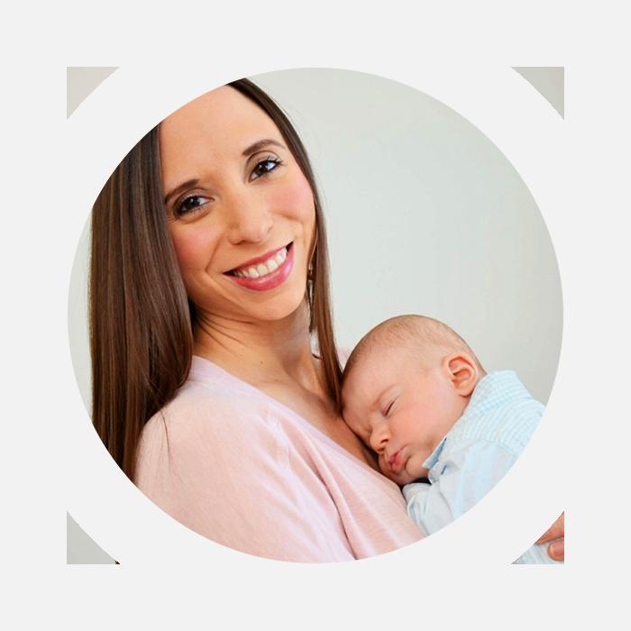 Dr. Rebecca holding newborn baby