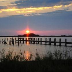 Sun setting at a pier.
