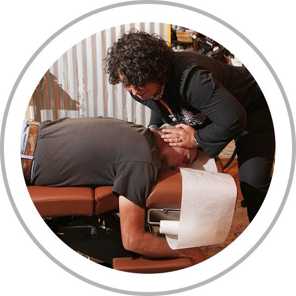 Dr. Kara adjusting patient