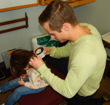 Sturgeon Bay chiropractor Dr. Levi Arnold gives child a chiropractic adjustment.