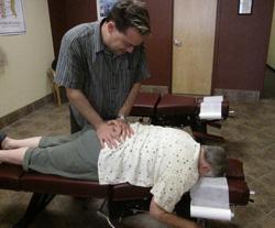 Dr. Marty adjusting a patient