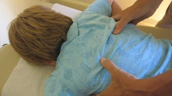 Dr. Politis adjusting a child.