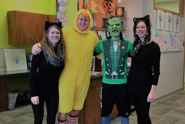 Dr. Scott and staff in Halloween outfits.