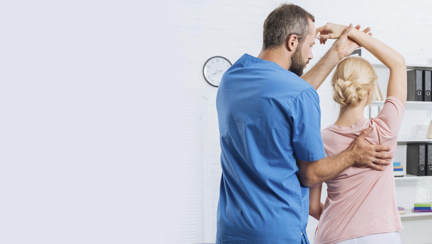 doctor adjusting patient back