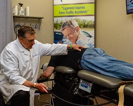 Dr Schmidt with man on adjusting table