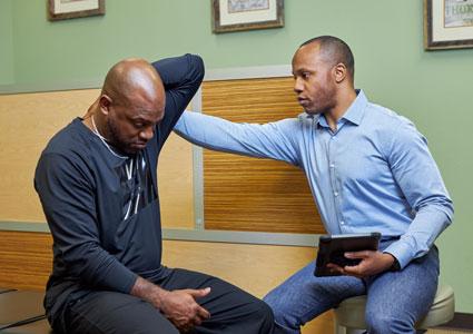 Dr. Anderson examining patient