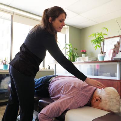 Dr. Vera adjusting patient