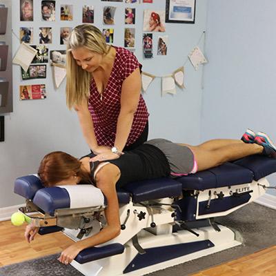 Dr. Theresa adjusting woman