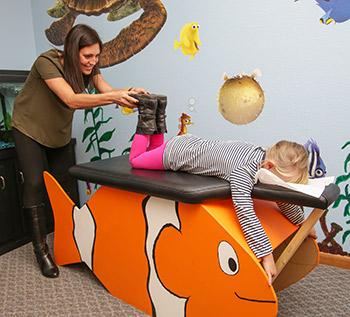 Dr. Stephanie Uthoff adjusting a child
