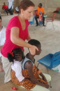 Dr. Schwab adjusting young girls in Africa.