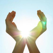 Hands grasping sun