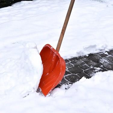 red shovel snow