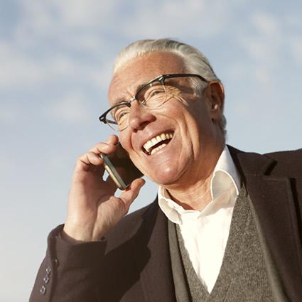 mature man talking on mobile phone