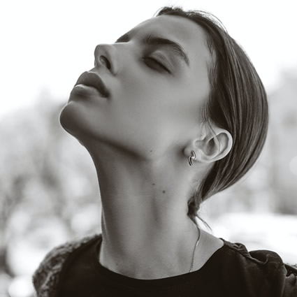 woman stretching neck up