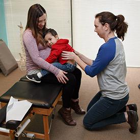 Dr. Tiffany adjusting child