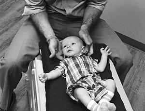 Adjusting a baby