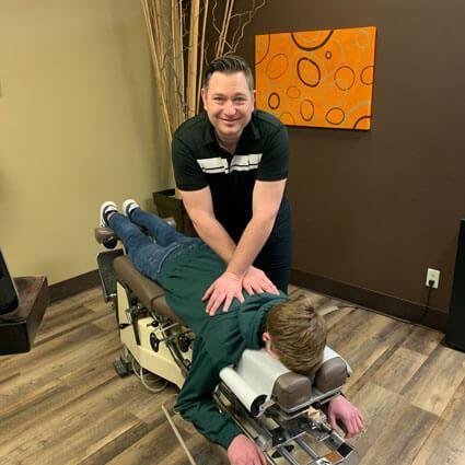 Dr. Wood adjusting patient