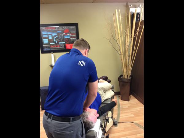 Dr. Tim Wood adjusts an adult patient