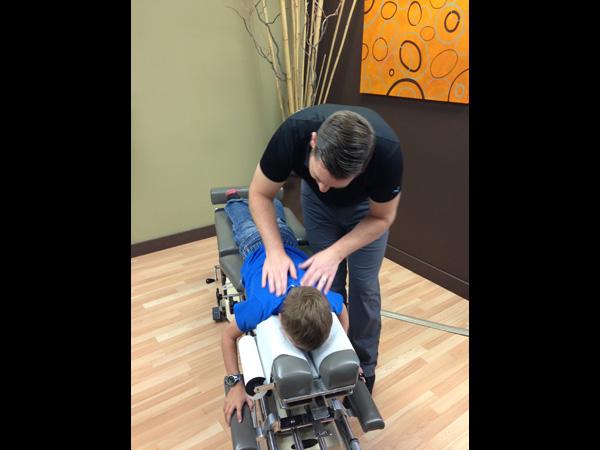 Paediatric chiropractic adjustment in {PJ}