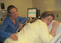 Newport Beach birth dula, Dr. Jennifer Angell assists a mother through childbirth.