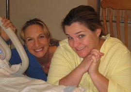 Newport Beach birth doula, Dr. Jennifer Angell assisting a mother through childbirth