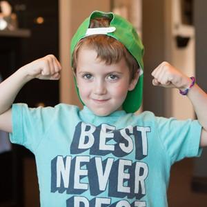 Boy flexing his arms