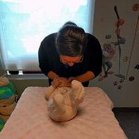 Dr. Manpreet Adjusting a Baby