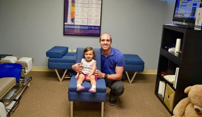 Dr. Robert Mirandola with child