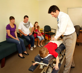 Leeming Chiropractor, Malcolm Rudd adjusting a patient.