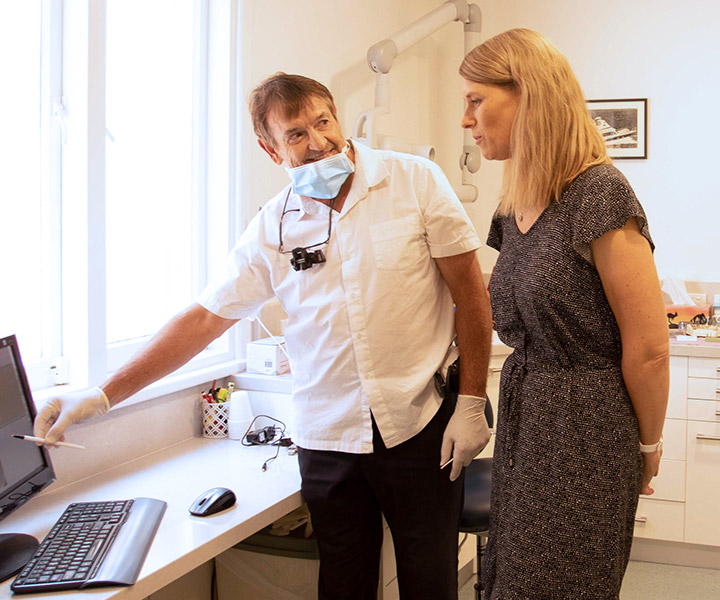 Dr John showing patient computer