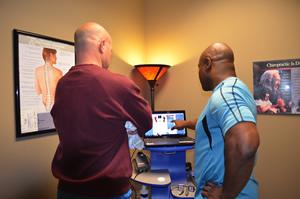 Brad Baker evaluating an abnormal foot scan