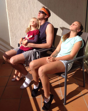 Dr. Brian and his daughters in the sun