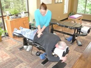 Dr. Kimberly Guthrie adjusting man