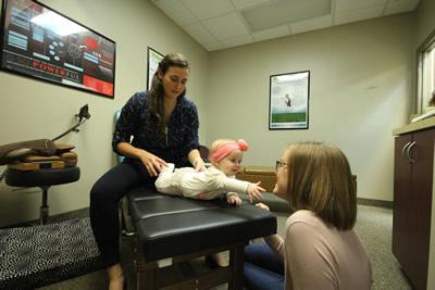 Dr. Sybil adjusting baby