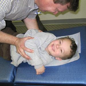 Sterling Heights Chiropractor Dr. Bence adjusting boy