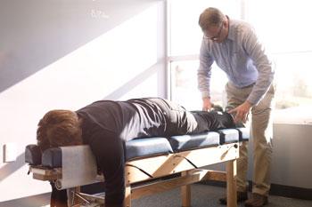 Dr. Tony Morman adjusting adult patient